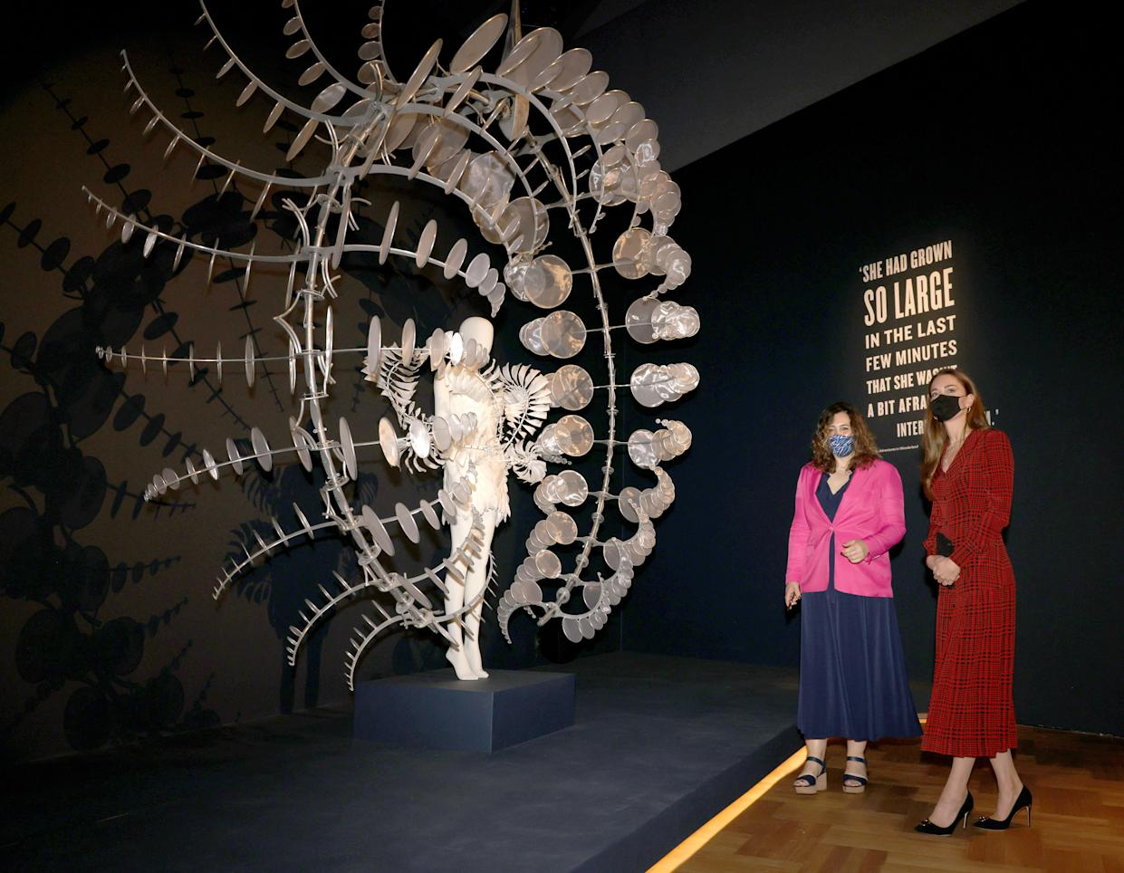 The Duchess of Cambridge in the Alice exhibition with curator Kate Bailey, looking at one of the costumes during a visit to V&A Museum in London. Picture date: Wednesday May 19, 2021.