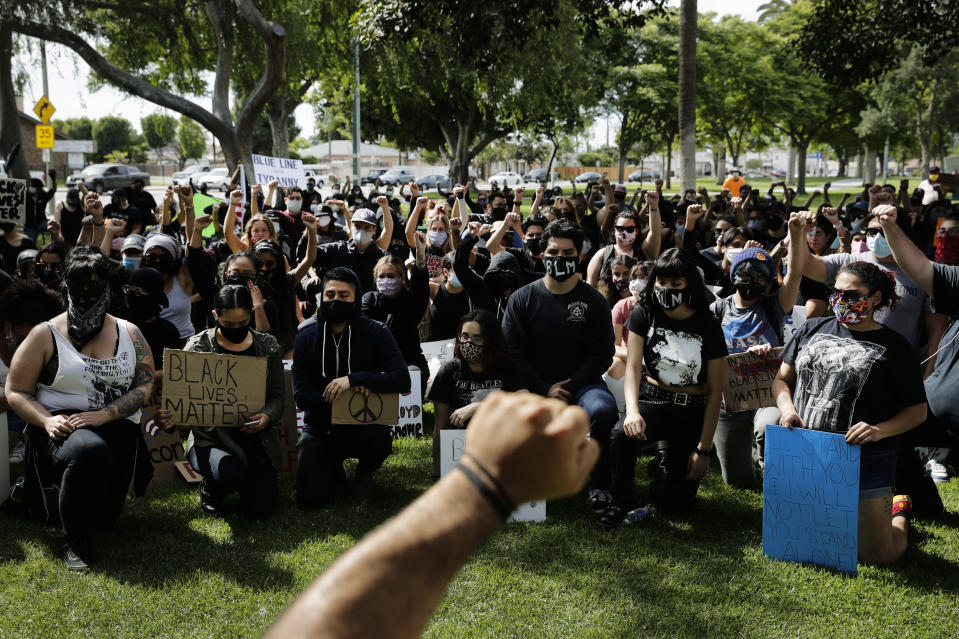 FILE - In this June 1, 2020, file photo, demonstrators raise their fists during a protest over the death of George Floyd in Anaheim, Calif. Thousands of Black activists from across the U.S. will hold the 2020 Black National Convention on Aug. 28, 2020, via livestream to produce a new political agenda that builds on the protests that followed George Floyd's death. Organizers of the gathering shared their plans with The Associated Press on Wednesday, July 1, ahead of an official announcement. (AP Photo/Jae C. Hong, File)