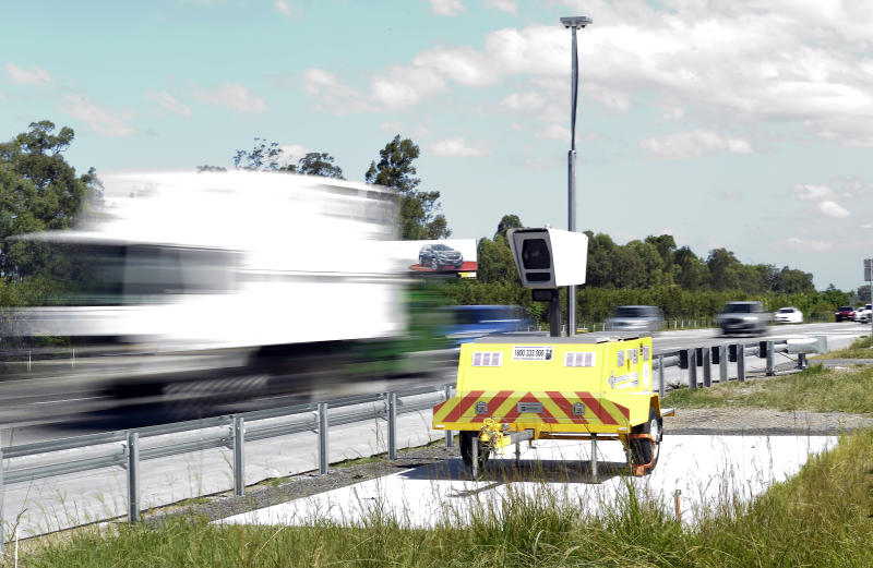 A mobile speed camera is seen on the M1 Motorway south of Brisbane.