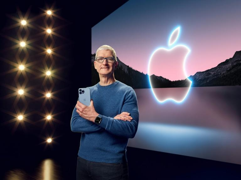 This handout image obtained September 14, 2021 courtesy of Apple Inc. shows Apple CEO Tim Cook with the iPhone 13 Pro Max and Apple Watch Series 7 (AFP/Handout)