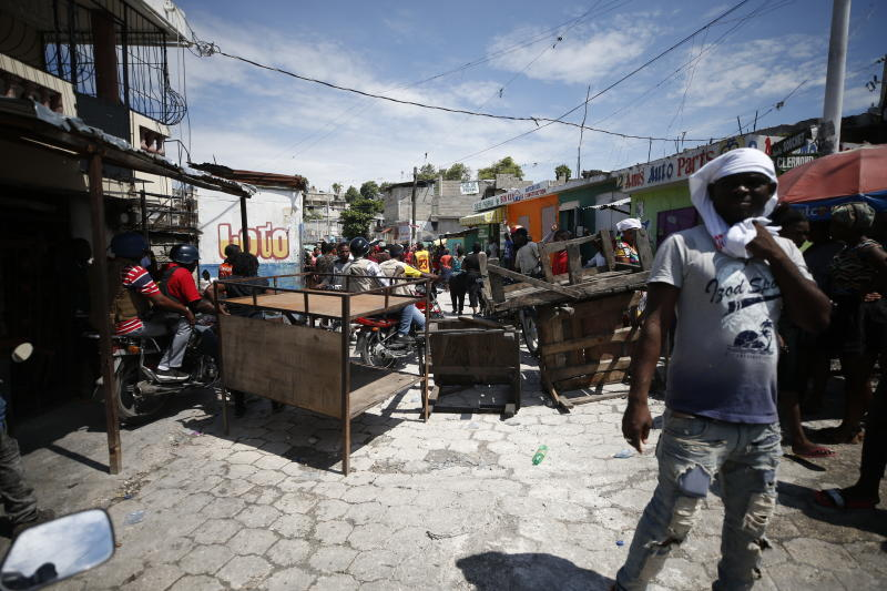Haitians gather for a nationwide push to block streets and paralyze the country's economy as they press for President Jovenel Moise to give up power, in Port-au-Prince, Haiti, Monday, Sept. 30, 2019. Opposition leaders and supporters say they are angry about public corruption, spiraling inflation and a dwindling supply of gasoline that has forced many gas stations in the capital to close as suppliers demand the cash-strapped government pay them more than $100 million owed. (AP Photo/Rebecca Blackwell)