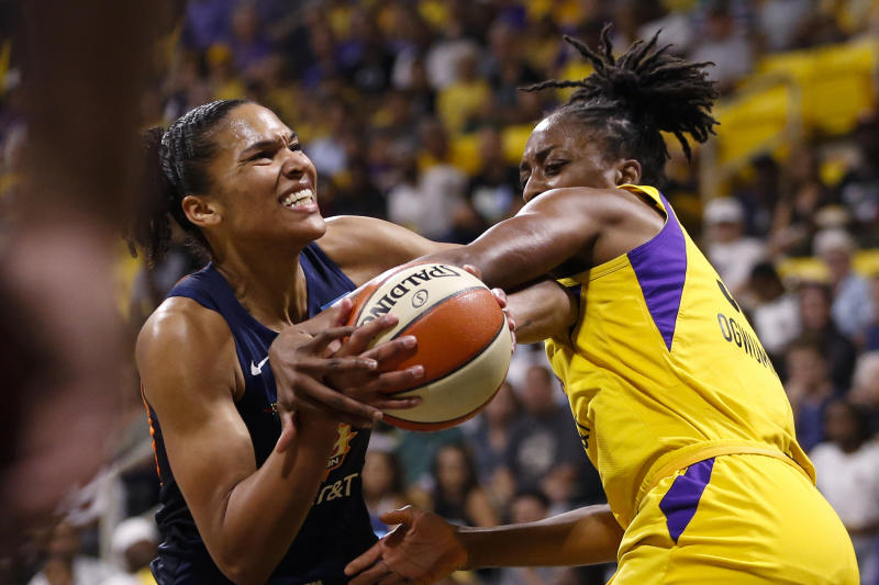 Connecticut Sun's Alyssa Thomas, left, is fouled by Los Angeles Sparks' Nneka Ogwumike during the first half of Game 3 of a WNBA basketball playoff game Sunday, Sept. 22, 2019, in Long Beach, Calf. (AP Photo/Ringo H.W. Chiu)