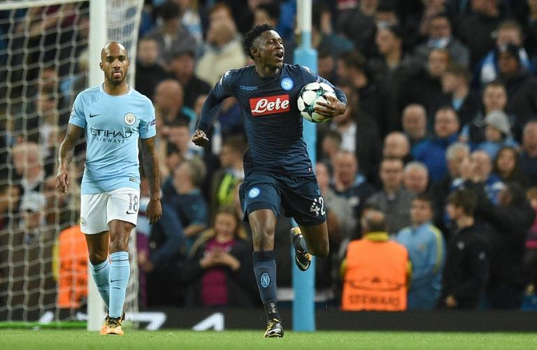 Napoli's midfielder Amadou Diawara celebrates scoring from the penalty spot against Manchester City on October 17, 2017