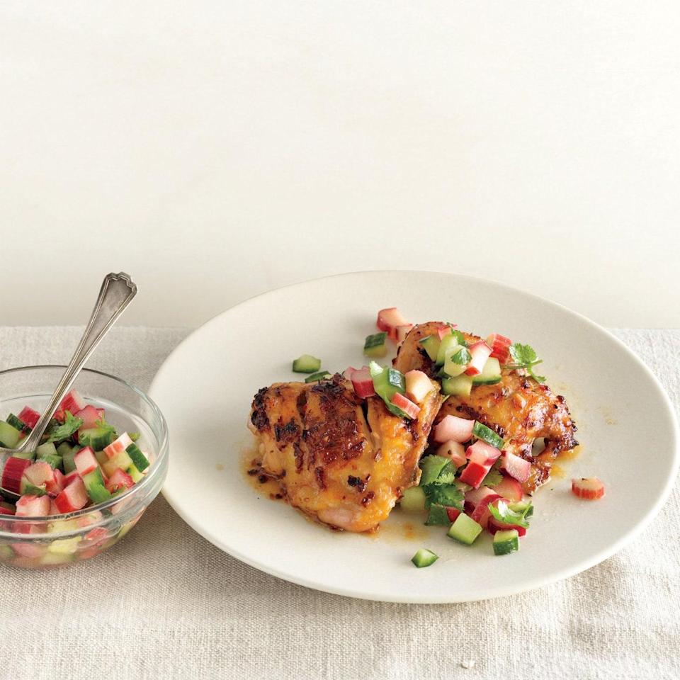 """A fresh salsa balances out the spiciness of these chile-glazed chicken thighs. <a href=""""https://www.epicurious.com/recipes/food/views/spicy-chicken-thighs-with-rhubarb-cucumber-salsa-395038?mbid=synd_yahoo_rss"""" rel=""""nofollow noopener"""" target=""""_blank"""" data-ylk=""""slk:See recipe."""" class=""""link rapid-noclick-resp"""">See recipe.</a>"""