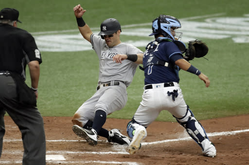 Meadows, Rays split with Yankees in 7-inning doubleheader