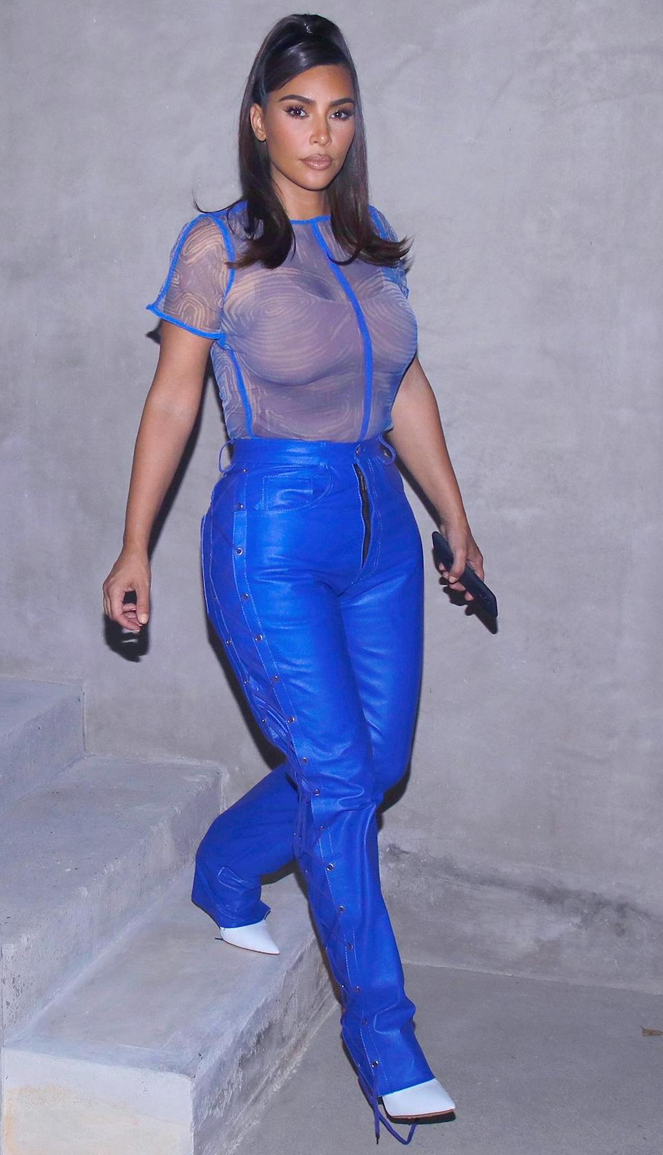 <p>Kim Kardashian West is seen leaving a friend's house wearing a chic cobalt blue sheer top and matching leather trousers on Tuesday in L.A.</p>