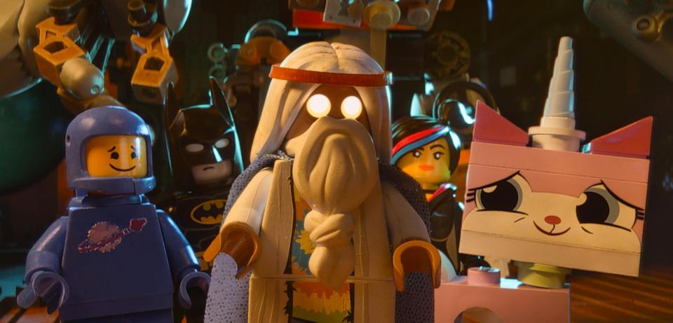 """This image released by Warner Bros. Pictures shows characters, from left, Benny, voiced by Charlie Day, Batman, voiced by Will Arnett, Vitruvius, voiced by Morgan Freeman, Wyldstyle, voiced by Elizabeth Banks and Unikitty, voiced by Alison Brie, in a scene from """"The Lego Movie."""" """"The LEGO Movie"""" is expected to take the top spot at the box office in its second weekend. (AP Photo/Warner Bros. Pictures, file)"""
