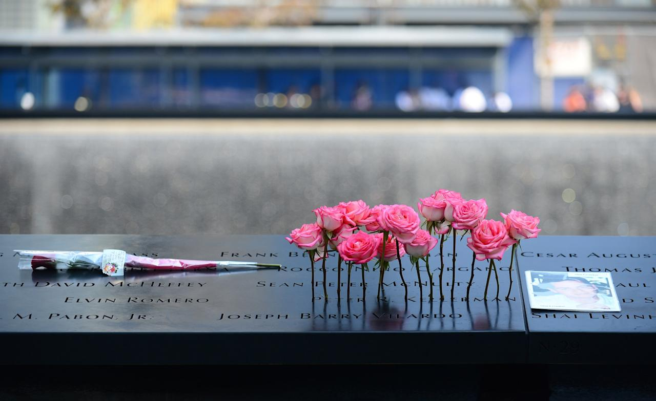 Flowers and a picture are placed in the wall at the 9/11 Memorial during a ceremony marking the 12th Anniversary of the attacks on the World Trade Center in New York September 11, 2013. REUTERS/  David Handschuh/Pool (UNITED STATES - Tags: DISASTER ANNIVERSARY)