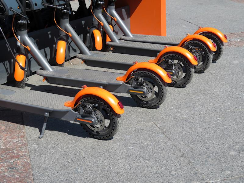 City bike rental system, public kick scooters on the street