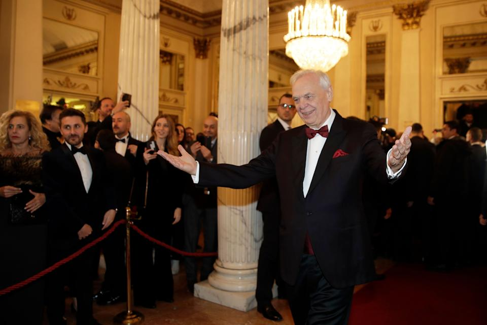 """La Scala general manager Alexander Pereira gestures in the foyer for the gala premiere of La Scala opera house, in Milan, Italy, Saturday, Dec. 7, 2019. Milan's storied La Scala opens its 2019-2020 season on Saturday with Puccini's """"Tosca,"""" which stars Russian soprano Anna Netrebko as the object of unwanted sexual attention from a powerful authority figure. (AP Photo/Luca Bruno) (Photo: ASSOCIATED PRESS)"""