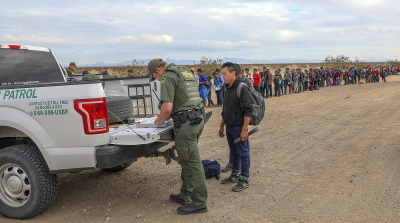 Customs and Border Protection shows some of 376 Central Americans the Border Patrol says it arrested in southwest Arizona the vast majority of them families who used short holes dug under a barrier to
