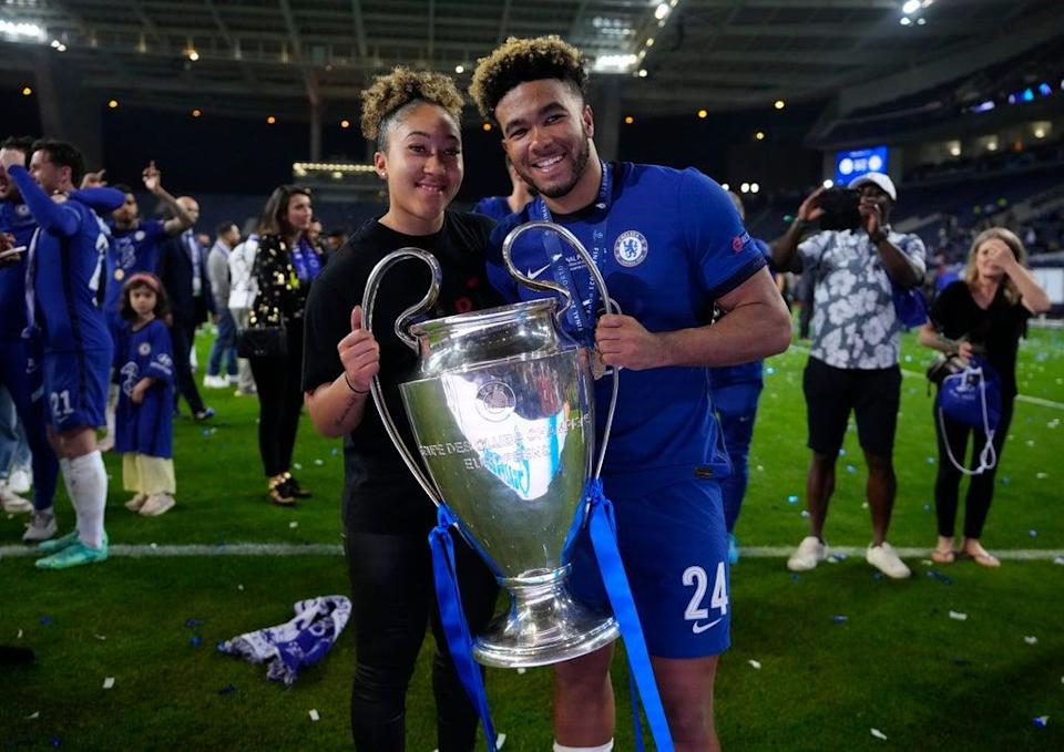 Chelsea's Reece James celebrates with the trophy after winning the Champions League in May 2021 (Pool via REUTERS)