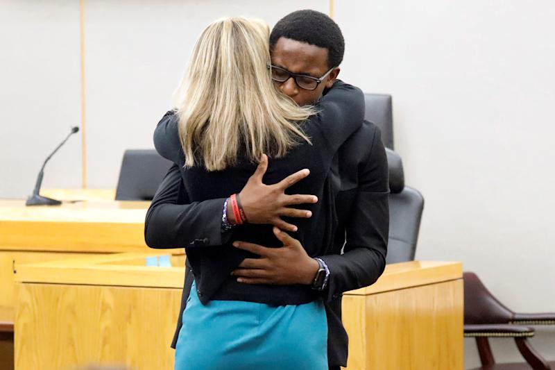 Botham Jean's younger brother Brandt Jean hugs former Dallas police officer Amber Guyger after delivering his impact statement to her following her 10-year prison sentence for murder at the Frank Crowley Courts Building in Dallas, Texas, U.S. October 2, 2019. Tom Fox/Pool via REUTERS MANDATORY CREDIT