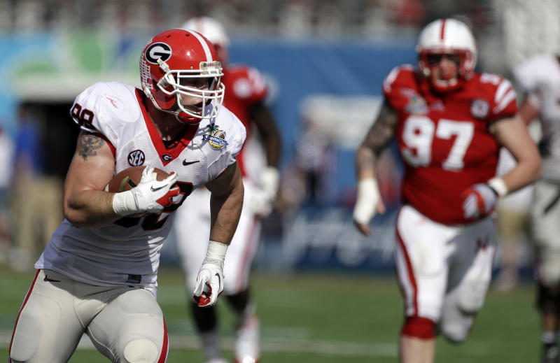 Georgia tight end Arthur Lynch, left, runs for a 29-yard touchdown on a pass play past Nebraska defensive tackle Chase Rome (97) during the first half of the Capital One Bowl NCAA football game, Tuesday, Jan. 1, 2013, in Orlando, Fla. (AP Photo/John Raoux)
