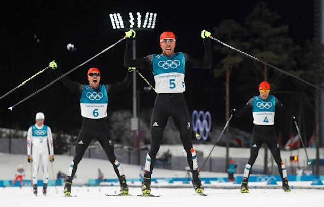 Nordic Combined Events - Pyeongchang 2018 Winter Olympics - Men's Individual 10 km Final - Alpensia Cross-Country Skiing Centre - Pyeongchang, South Korea - February 20, 2018 - Gold medalist, Johannes Rydzek of Germany, silver medalist, Fabian Riessle of Germany and bronze medalist Eric Frenzel of Germany react as they cross the finish line. REUTERS/Kai Pfaffenbach TPX IMAGES OF THE DAY