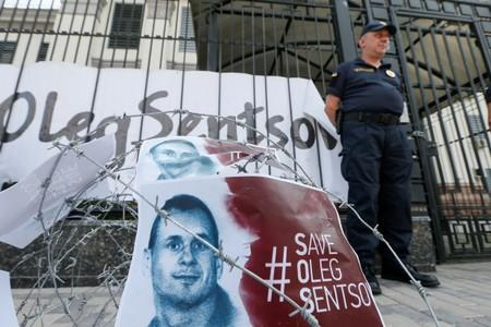 FILE PHOTO: Barbed wire and placards with images of Ukrainian film director Sentsov are seen after a rally in Kiev