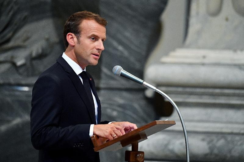 """Macron said he was """"truly moved"""" to be made an honorary canon of St John Lateran, the cathedral of Rome (AFP Photo/Alberto PIZZOLI)"""