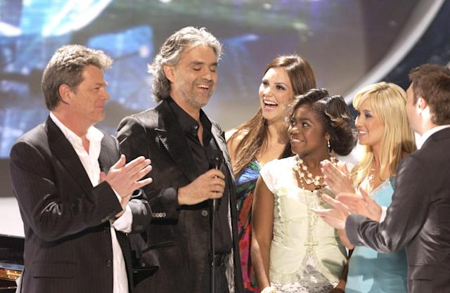 David Foster, left, and Andrea Bocelli appear on <em>American Idol</em> with contestants Katharine McPhee, Paris Bennett, and Kellie Pickler, as well as host Ryan Seacrest in 2006. (Photo: Ray Mickshaw/WireImage for Fox Television Network)
