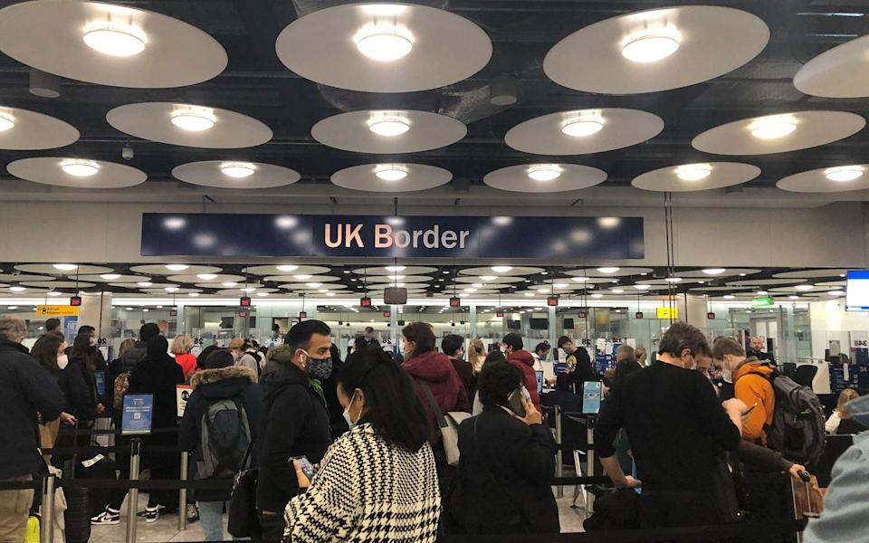 People queue at terminal 5 of Heathrow Airport, as the coronavirus pandemic continues and Britain tightens travel restrictions - PIA JOSEPHSON via REUTERS
