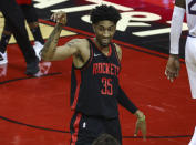 Houston Rockets center Christian Wood (35) reacts after a play against the Phoenix Suns during the second quarter of an NBA basketball game in Houston, Monday, April 5, 2021. (Troy Taormina/Pool Photo via AP)