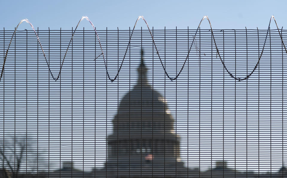 Fencing and razor wire surrounds the perimeter of the Capitol in Washington, Thursday, Feb. 25, 2021. (AP Photo/J. Scott Applewhite)