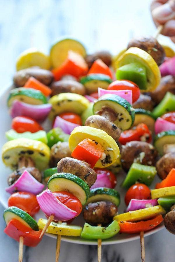 """<p>Grilled vegetable kabobs are a must at any outdoor party, and you can customize them to everyone's preferences. </p> <p><strong>Get the recipe:</strong> <a href=""""http://damndelicious.net/2014/08/22/vegetable-kabobs/"""" target=""""_blank"""" class=""""ga-track"""" data-ga-category=""""Related"""" data-ga-label=""""http://damndelicious.net/2014/08/22/vegetable-kabobs/"""" data-ga-action=""""In-Line Links"""">vegetable kabobs</a></p>"""