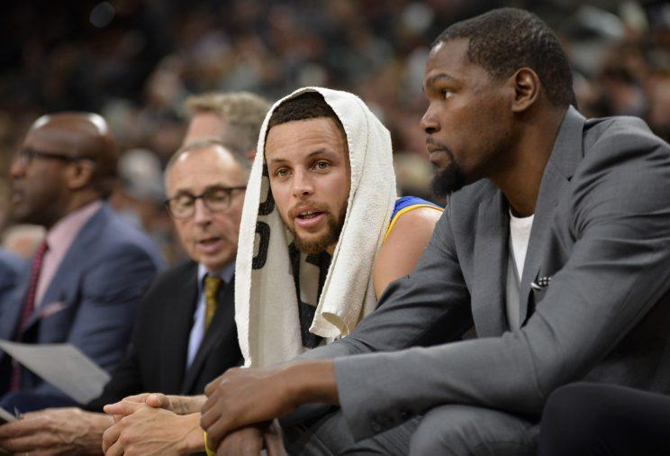 The Warriors are on fire and Kevin Durant is still wearing a suit with a t-shirt. (AP)