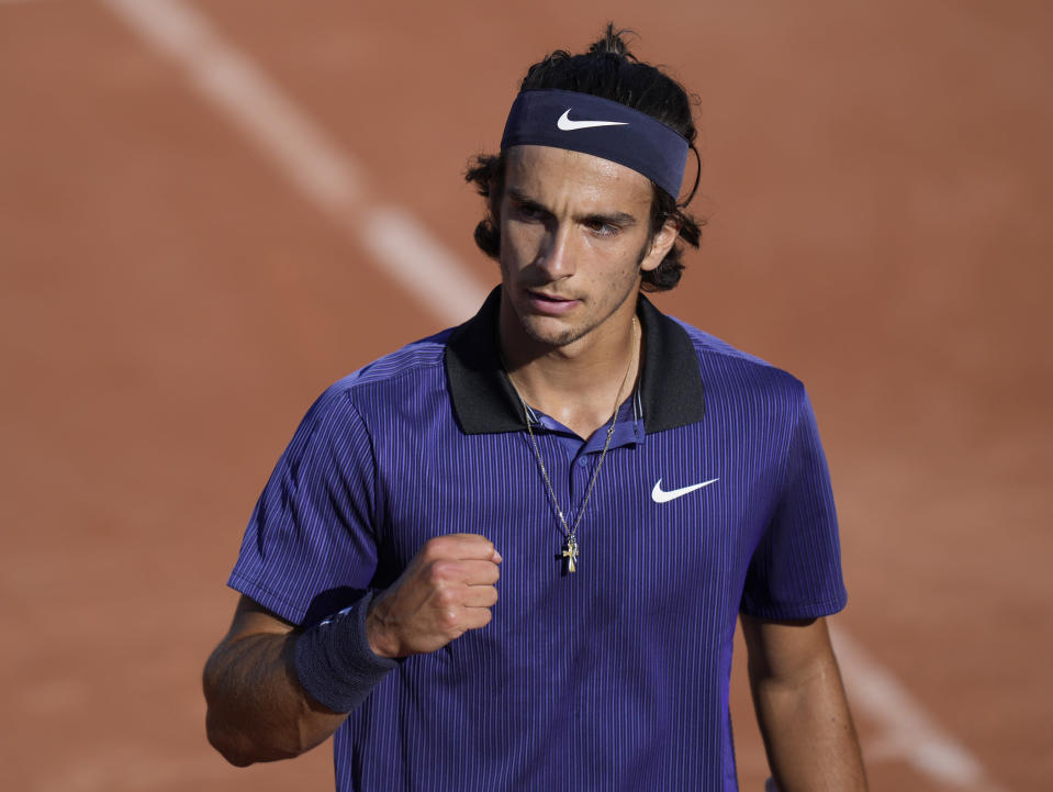 Italy's Lorenzo Musetti celebrates after winning a point against Belgium's David Goffin during their first round match on day two of the French Open tennis tournament at Roland Garros in Paris, France, Monday, May 31, 2021. (AP Photo/Thibault Camus)
