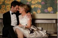 <p>Leslie and Ben didn't get along at first, but isn't that how all great relationships start? The two married, fittingly, at the Parks Department office during season 5, and Leslie wore a short pleated dress made from lace, tulle, newspaper clippings, and documents of all of her biggest victories from the show. </p>