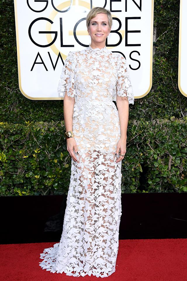 <p>Kristen Wiig attended the Golden Globes dressed as a doily. (ICYDK, doilies are small ornamental, lacy mats adored by grandmas around the world.) While the see-through trend has been going strong for some time now, something about the version here looked more geriatric than edgy. Maybe it was the high neck. Maybe it was the elbow-length sleeves. Maybe it was the white-on-white effect of the white lace on top of her not-so-tan skin. Whatever it was, it was a miss. She should stand by Carrie Underwood (who is dressed like a confection) for a photo, though. (Photo: Venturelli/WireImage) </p>