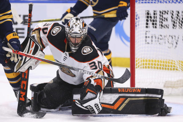 Anaheim Ducks goalie Ryan Miller (30) makes a glove save during the third period of an NHL hockey game against the Buffalo Sabres, Sunday, Feb. 9, 2020, in Buffalo, N.Y. (AP Photo/Jeffrey T. Barnes)