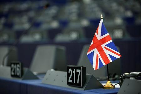 A Union Jack flag is seen on the desk of a Member of the European Parliament ahead of a debate on BREXIT after the vote on british Prime Minister Theresa May's Brexit deal, at the European Parliament in Strasbourg, France, January 16, 2019. REUTERS/Vincent Kessler
