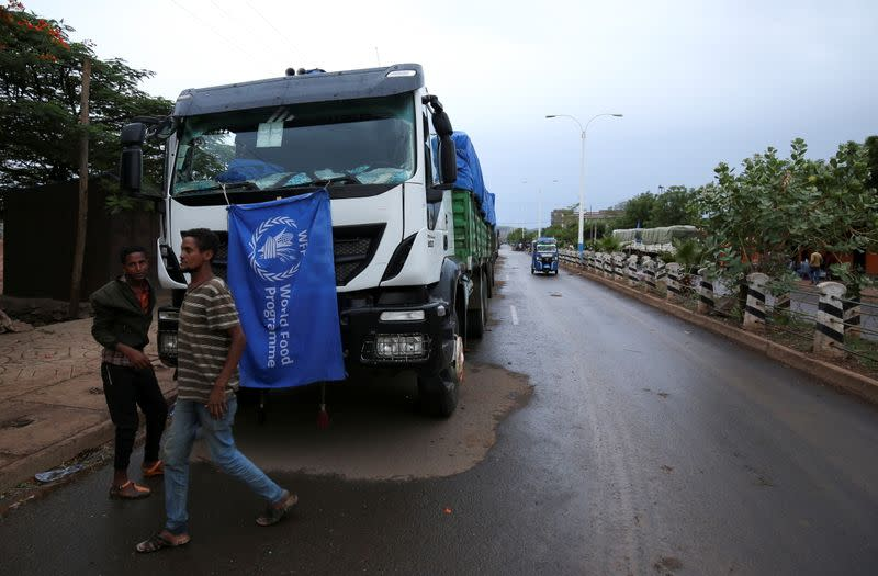 The World Food Program (WFP) convoy trucks carrying food items for the victims of Tigray war are seen parked after the checkpoints leading to Tigray Region were closed, in Mai Tsebri town