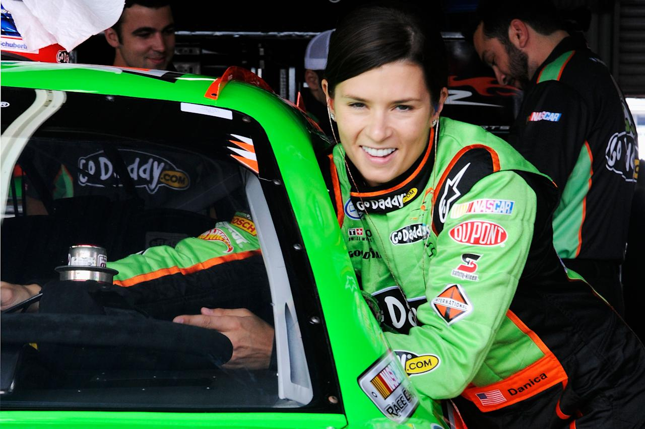 TALLADEGA, AL - MAY 04:  Danica Patrick, driver of the #7 GoDaddy.com Chevrolet, stands next to her car in the garage area during practice for the NASCAR Nationwide Series Aaron's 312 at Talladega Superspeedway on May 4, 2012 in Talladega, Alabama.  (Photo by John Harrelson/Getty Images for NASCAR)