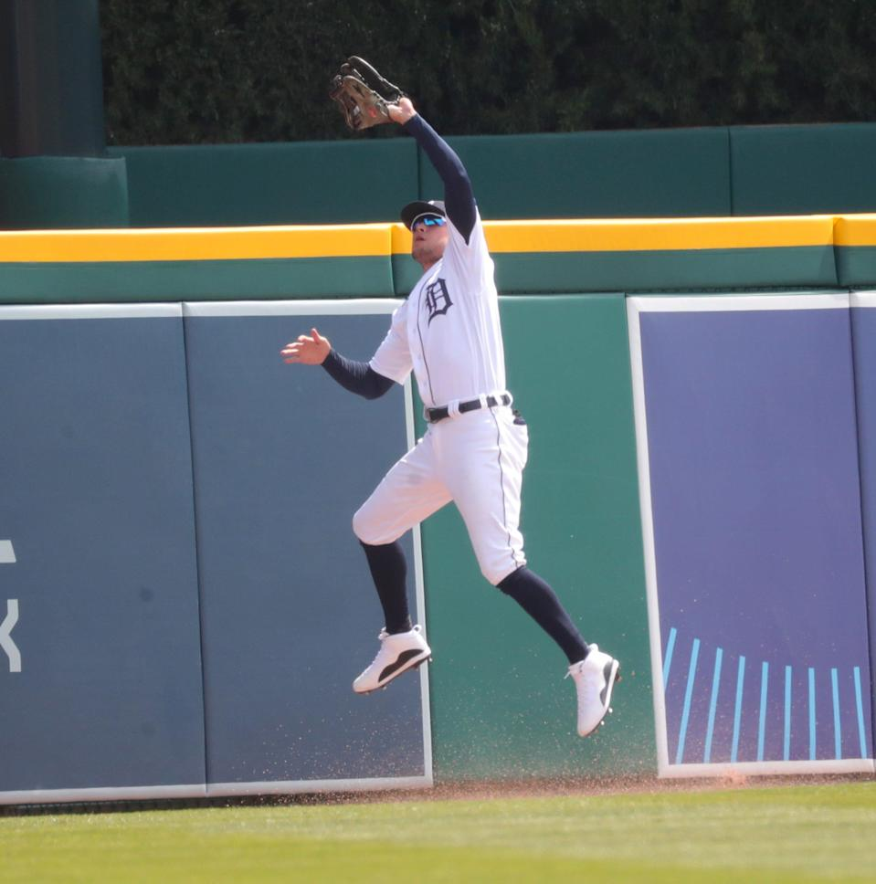Detroit Tigers left fielder JaCoby Jones (21) catches a fly ball hit by Minnesota Twins second baseman Luis Arraez (2) during fourth inning action Tuesday, April 6, 2021 at Comerica Park in Detroit.