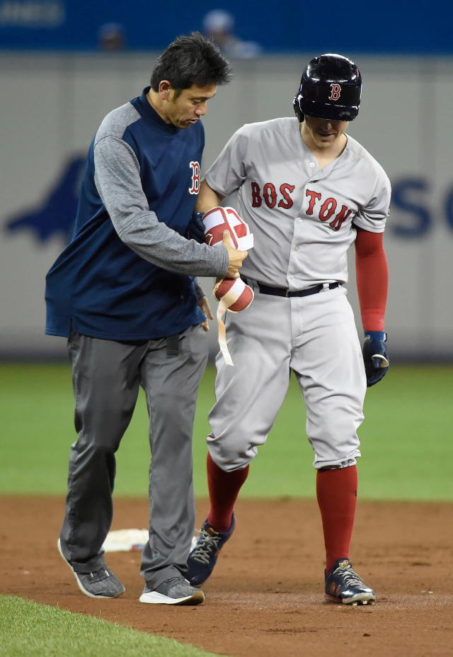 Boston Red Sox second baseman Brock Holt leaves with an injury during the third inning of the team's baseball game against the Toronto Blue Jays in Toronto on Thursday, April 26, 2018. (Nathan Denette/The Canadian Press via AP)
