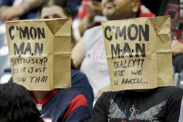 Houston Texans fans cover their heads during the third quarter of an NFL football game against the St. Louis Rams Sunday, Oct. 13, 2013, in Houston, Texas. (AP Photo/Eric Gay)