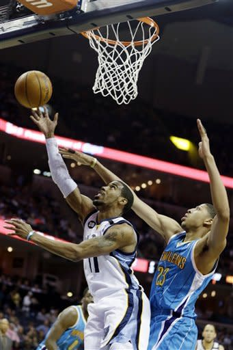 Memphis Grizzlies' Mike Conley (11) goes to the basket in front of New Orleans Hornets' Anthony Davis (23) during first half of an NBA basketball game in Memphis, Tenn., Saturday, March 9, 2013. (AP Photo/Danny Johnston)
