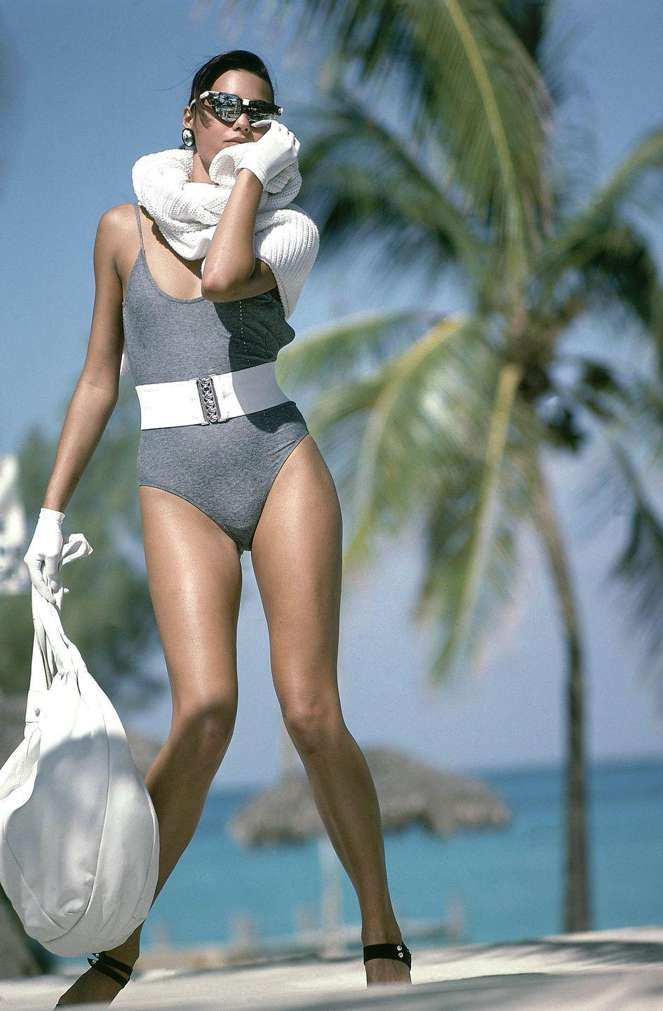 <p>When you think of '80s swimsuits, odds are you imagine something like this gray suit with a thick white belt from a 1985 editorial.</p>