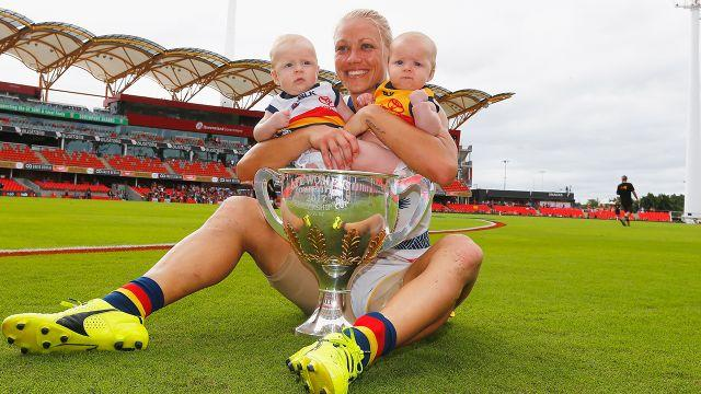 Phillips and her twins Brooklyn and Blake after winning the inaugural AFLW premiership. Image: Getty