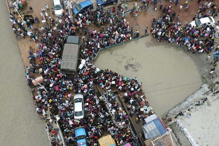 Tens of thousands of migrant workers fled Bangladesh's capital on the eve of a tightened lockdown