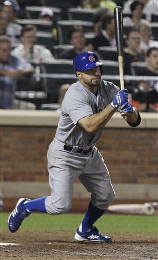 Chicago Cubs' Reed Johnson follows through on a single during the eighth inning of a baseball game against the New York Mets on Friday, July 6, 2012, in New York. (AP Photo/Frank Franklin II)