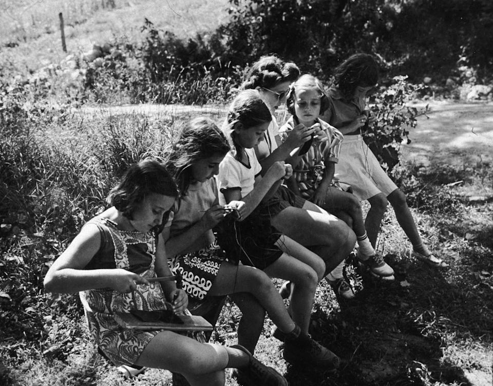<p>One camp skill girls wanted to learn? Knitting. Here, a counselor showed them how it's done. </p>