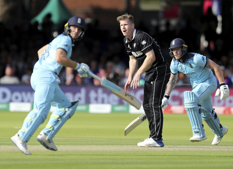 New Zealand's James Neesham, center, reacts as England's Jos Buttler, left, and Ben Stokes run between the wickets to score during the Cricket World Cup final match between England and New Zealand at Lord's cricket ground in London, England, Sunday, July 14, 2019. (AP Photo/Aijaz Rahi)