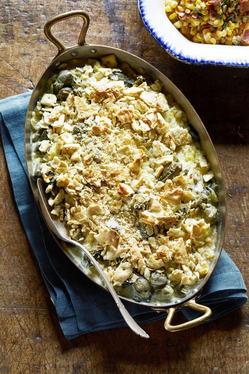 "<p>Just because it's cooler outside doesn't mean you can't bring a little bit of the ocean to your table. This dish is inspired by the sea and infuses oysters with leeks, vermouth, and saltines for an irresistible crunch.</p><p><strong><a href=""https://www.countryliving.com/food-drinks/a29132365/scalloped-oysters-recipe/"" rel=""nofollow noopener"" target=""_blank"" data-ylk=""slk:Get the recipe"" class=""link rapid-noclick-resp"">Get the recipe</a>.</strong></p><p><strong><a class=""link rapid-noclick-resp"" href=""https://www.amazon.com/dp/B074Z5X8MT/?tag=syn-yahoo-20&ascsubtag=%5Bartid%7C10050.g.896%5Bsrc%7Cyahoo-us"" rel=""nofollow noopener"" target=""_blank"" data-ylk=""slk:SHOP BAKING DISHES"">SHOP BAKING DISHES</a><br></strong></p>"