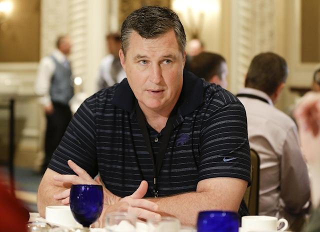 Buffalo Bills head coach Doug Marrone talks with reporters during the AFC Head Coaches Breakfast at the NFL football annual meeting in Orlando, Fla., Tuesday, March 25, 2014. (AP Photo/John Raoux)