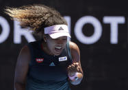 Japan's Naomi Osaka reacts after winning a point against Taiwan's Hsieh Su-Wei during their third round match at the Australian Open tennis championships in Melbourne, Australia, Saturday, Jan. 19, 2019. (AP Photo/Kin Cheung)
