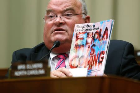 Long holds up a copy of a magazine with an Ebola headline as public health officials testify before a House Energy and Commerce Oversight and Investigations Subcommittee hearing on the U.S. response to the Ebola crisis, in Washington