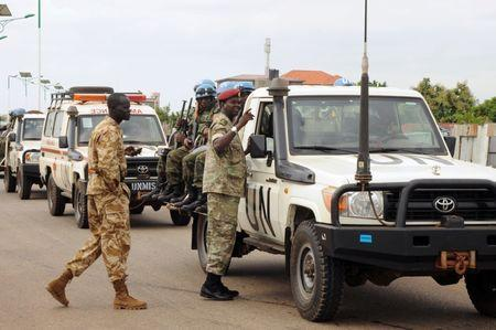 U.N. peacekeepers and South Sudan National security members ride on their truck as they protect internally displaced people during a reallocation at the United Nations Mission in South Sudan (UNMISS) compound at the UN House in Jebel, in South Sudan's capital Juba, August 31, 2016. REUTERS/Jok Solomun