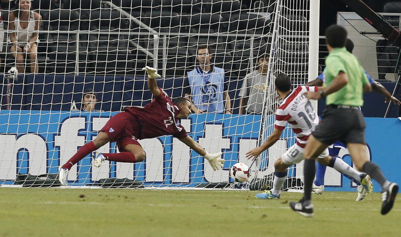 Honduras' goal keeper Donis Escobar (22) is unable to stop a shot by United States' Landon Donovan (10) during the first half of the Gold Cup semifinals at Cowboys Stadium, Wednesday, July 24, 2013, in Arlington, Texas. (AP Photo/Brandon Wade)